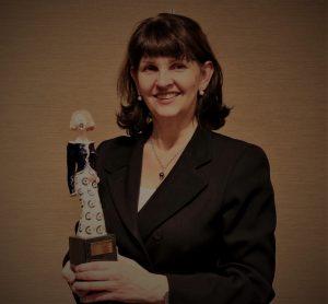 Rita Smyth with award
